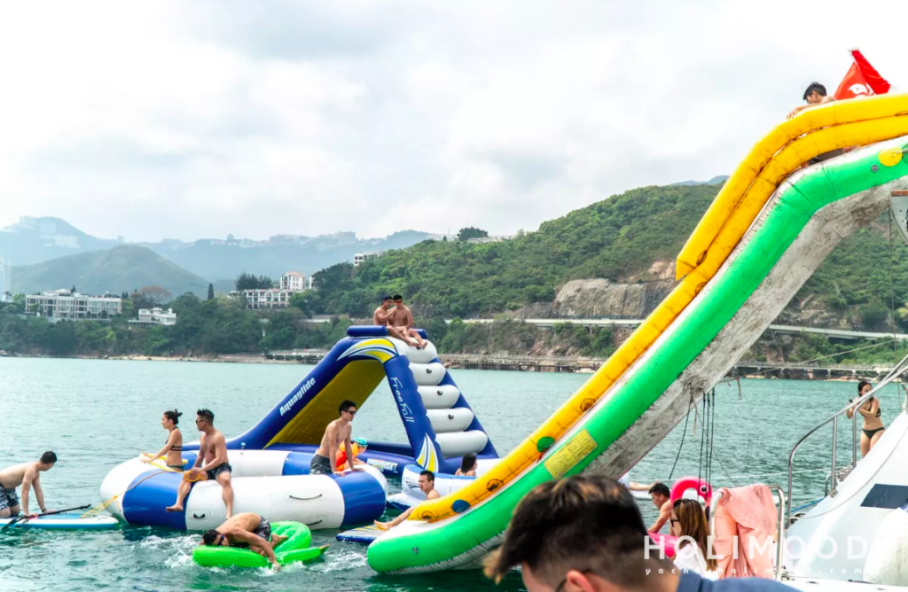 Yachting: people having fun on floats and trampolines
